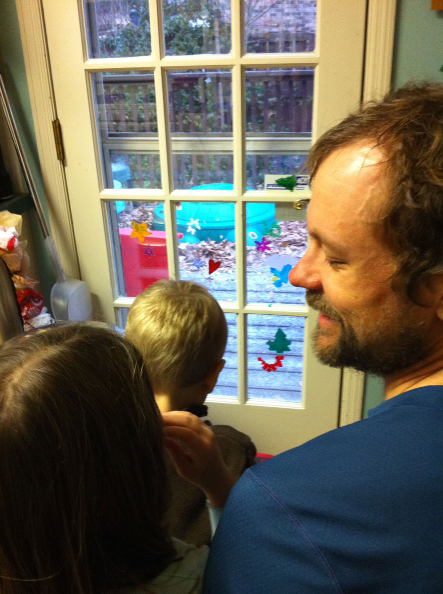 Drawing the kids away from the Packers game to watch the first flakes of snow (aka sleet)