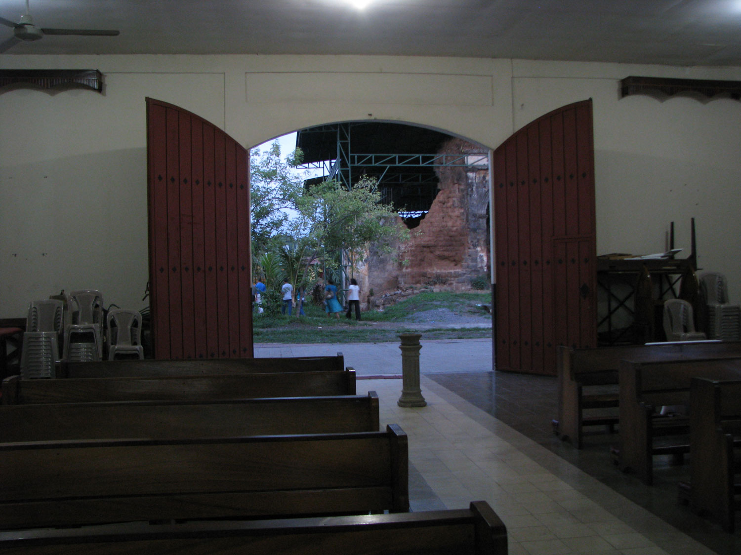View from within the rebuilt church looking at the old church bombed during the Sandinista revolution in the 70s