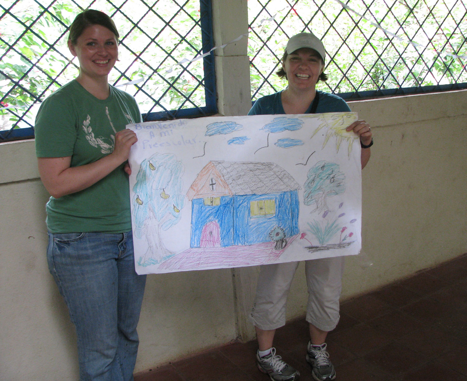 Bronwyn and Kristine pose with the drawing made by the preschool kids (3, 4, and 5 year olds)