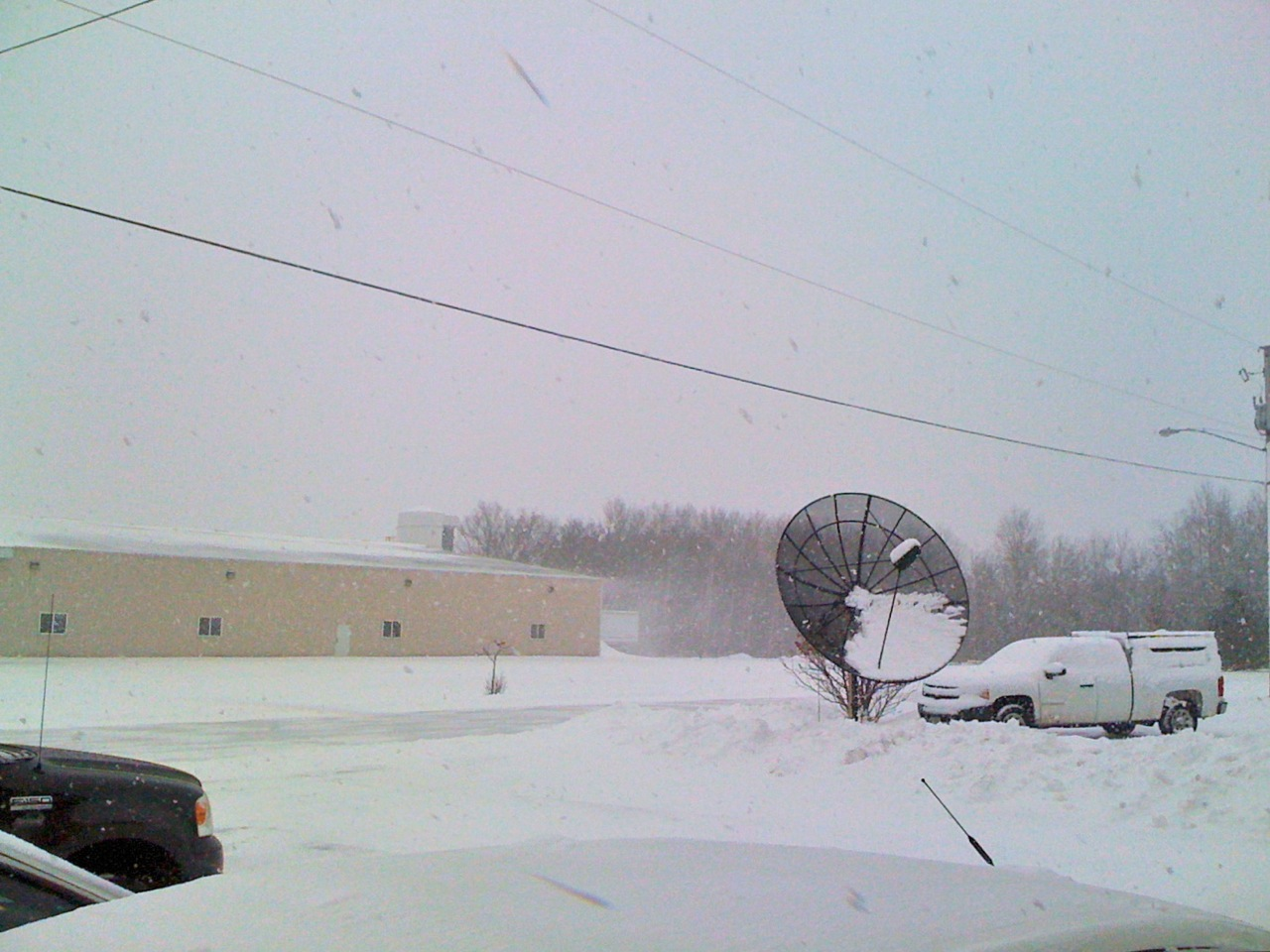 Look at the snow blowing off the roof of the warehouse